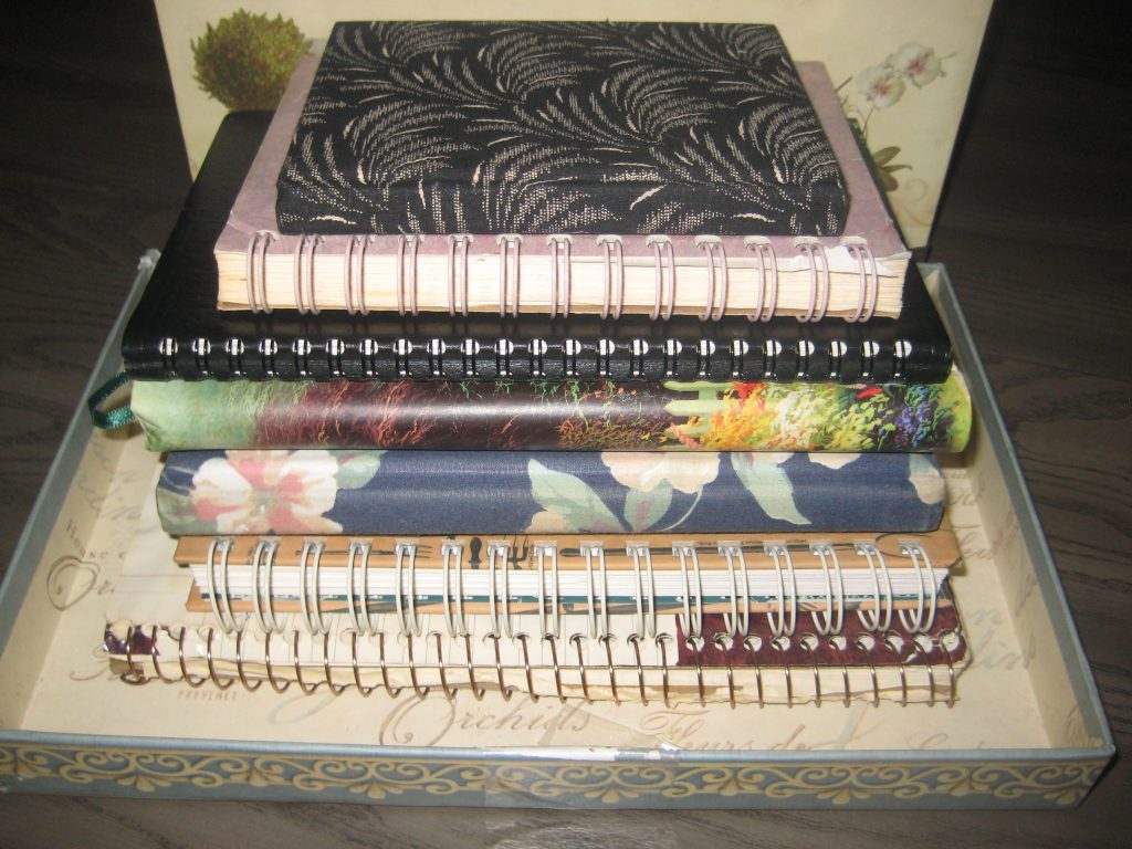 stack of used journals