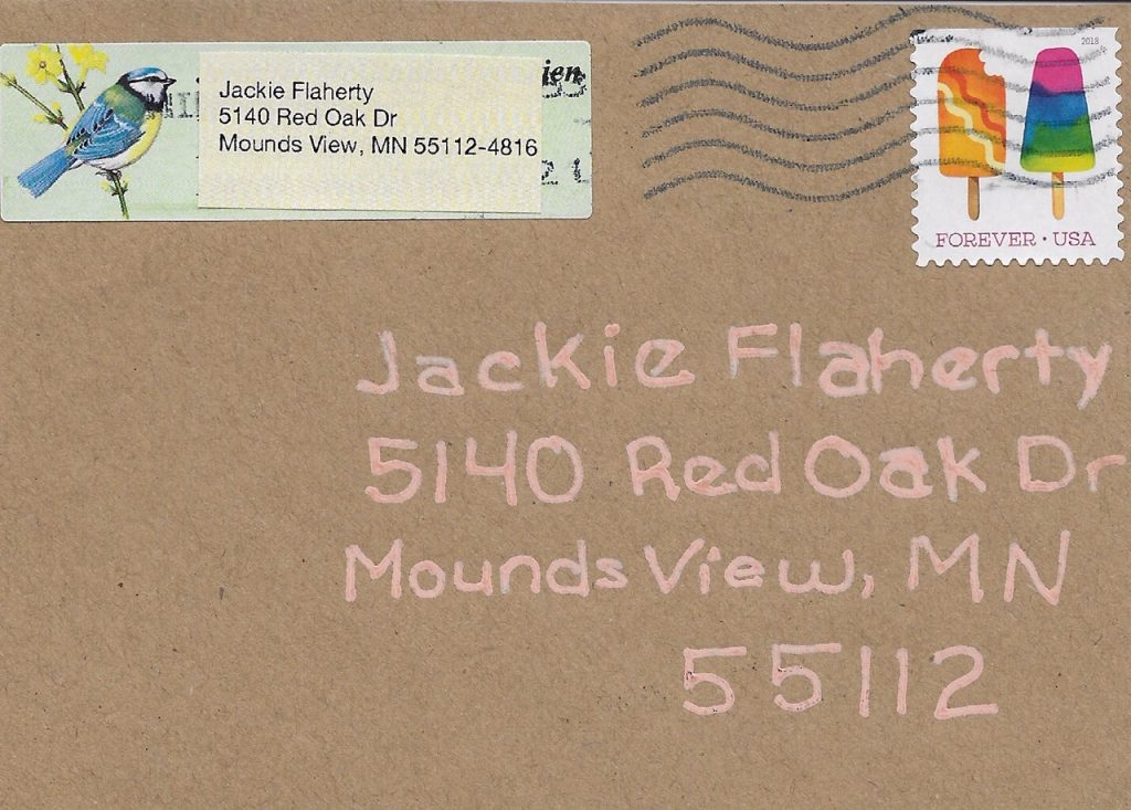 front of an envelope with address, stampand postmark