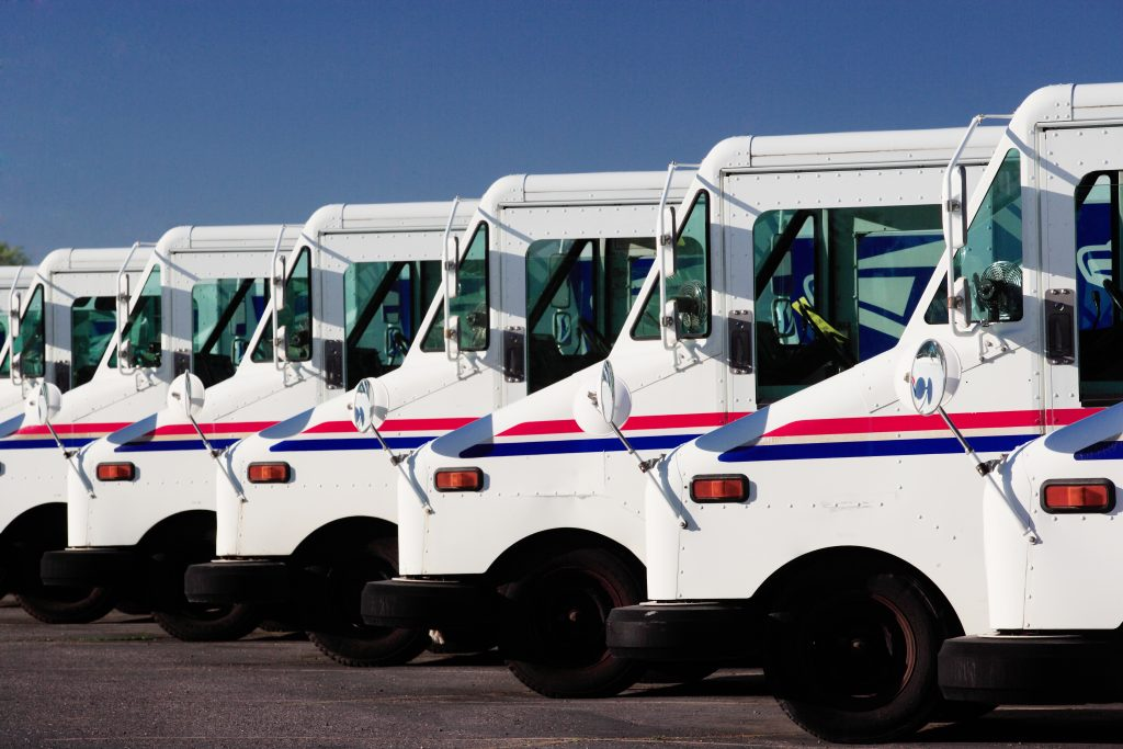 photo of US postal service trucks front ends