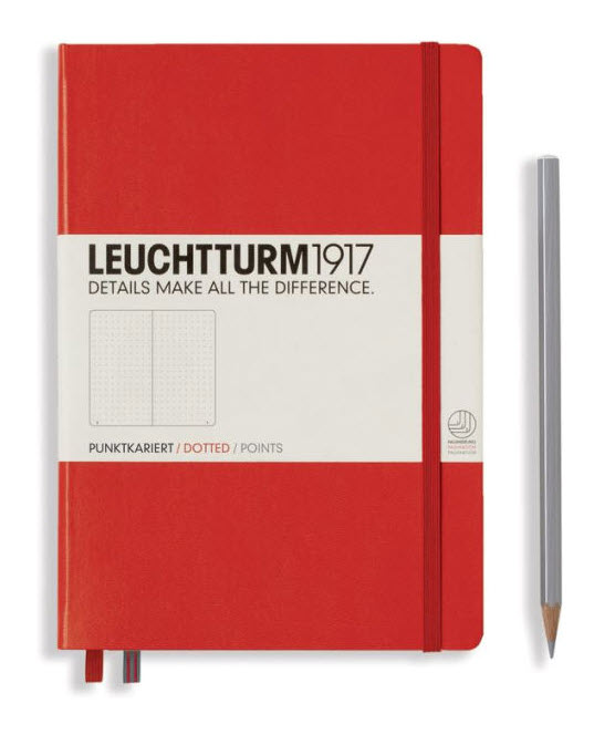 red journal cover with gray pencil next to it