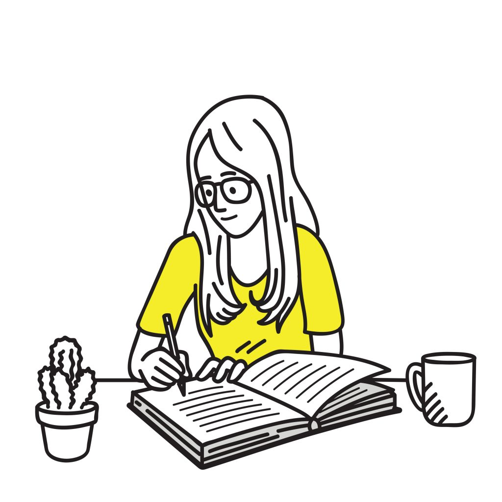 girl in yellow shirt writing in a journal, sitting at a desk
