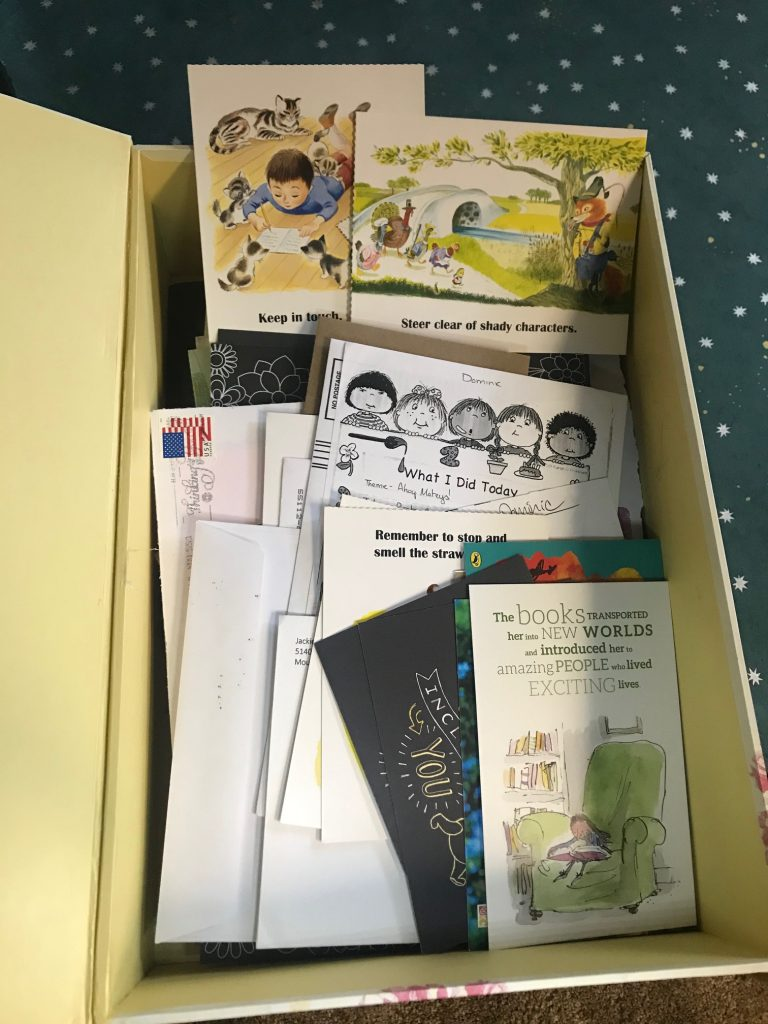 box contains postcards, letters, envelopes