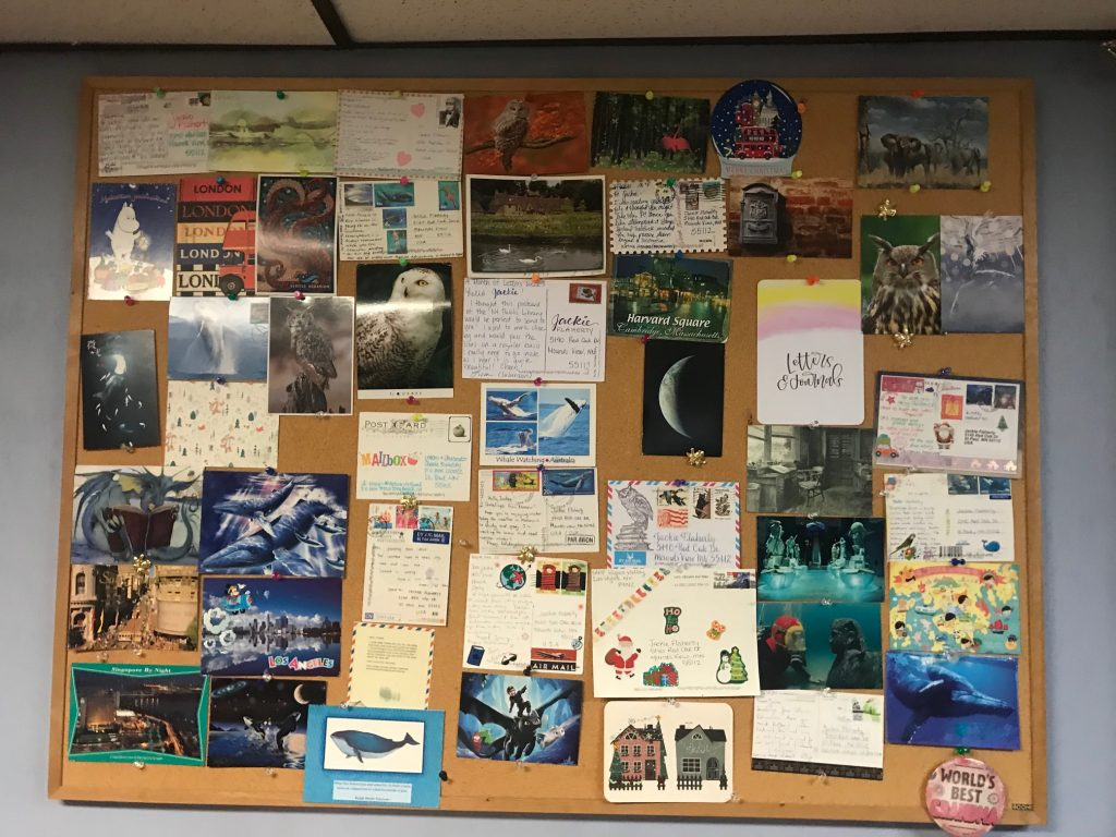 photo of large bulletin board covered in mail