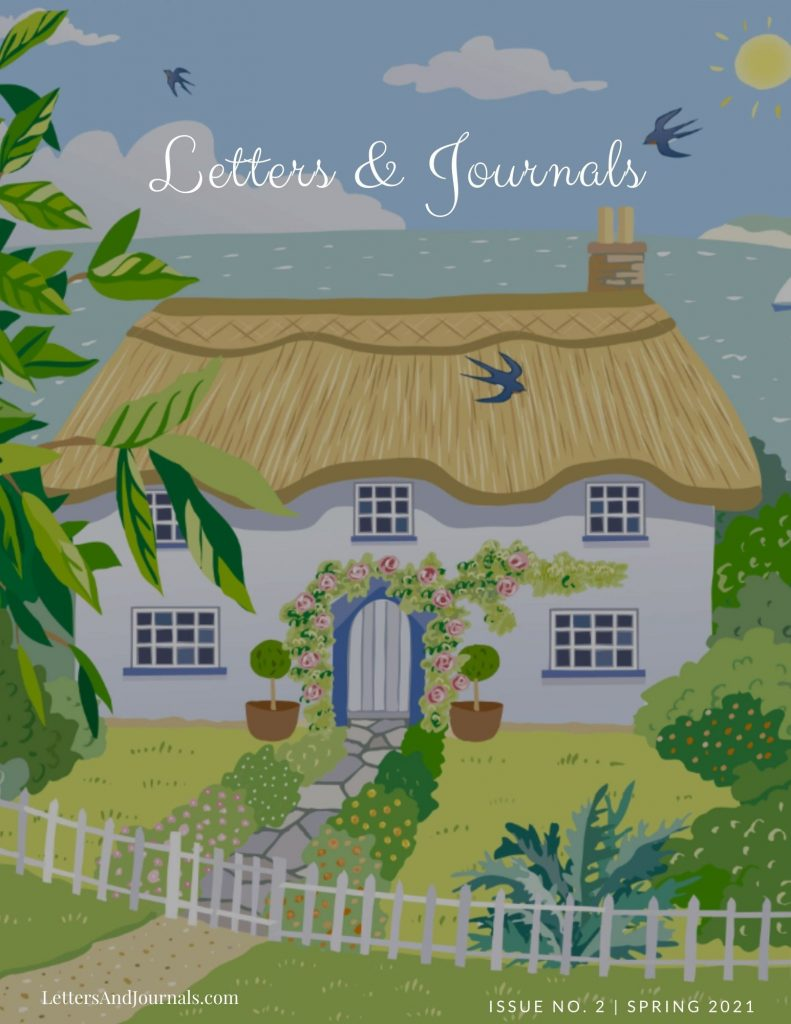 Magazine front cover features a cottage on a lovely summer day