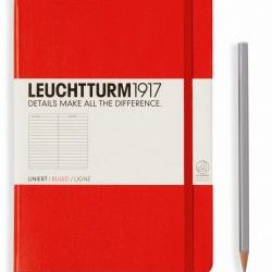 red journal with gray pencil next to it